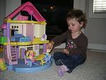 Addison and her doll house.